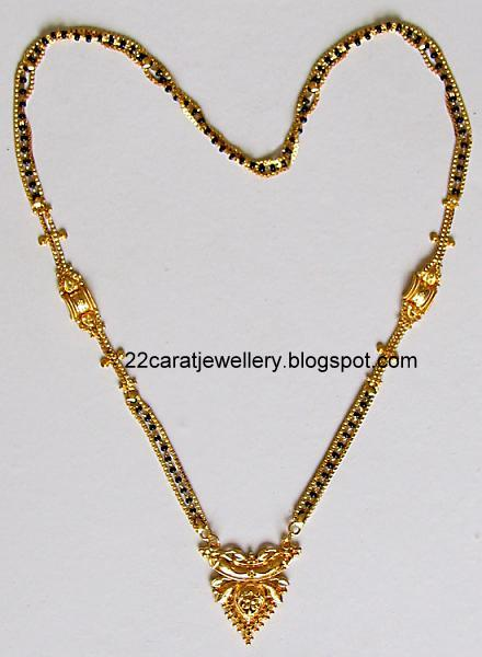 Diamond necklace set by khazana jewellers latest jewellery designs - 22 Carat Nallapusalu Black Beads Jewellery Jewellery Designs