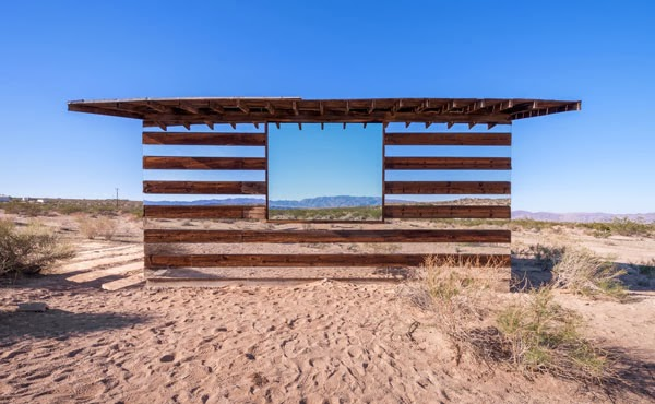 mirror art house in desert