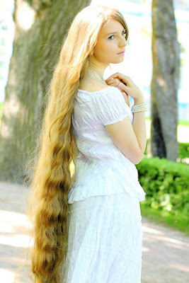 very beautiful young woman with very long hair