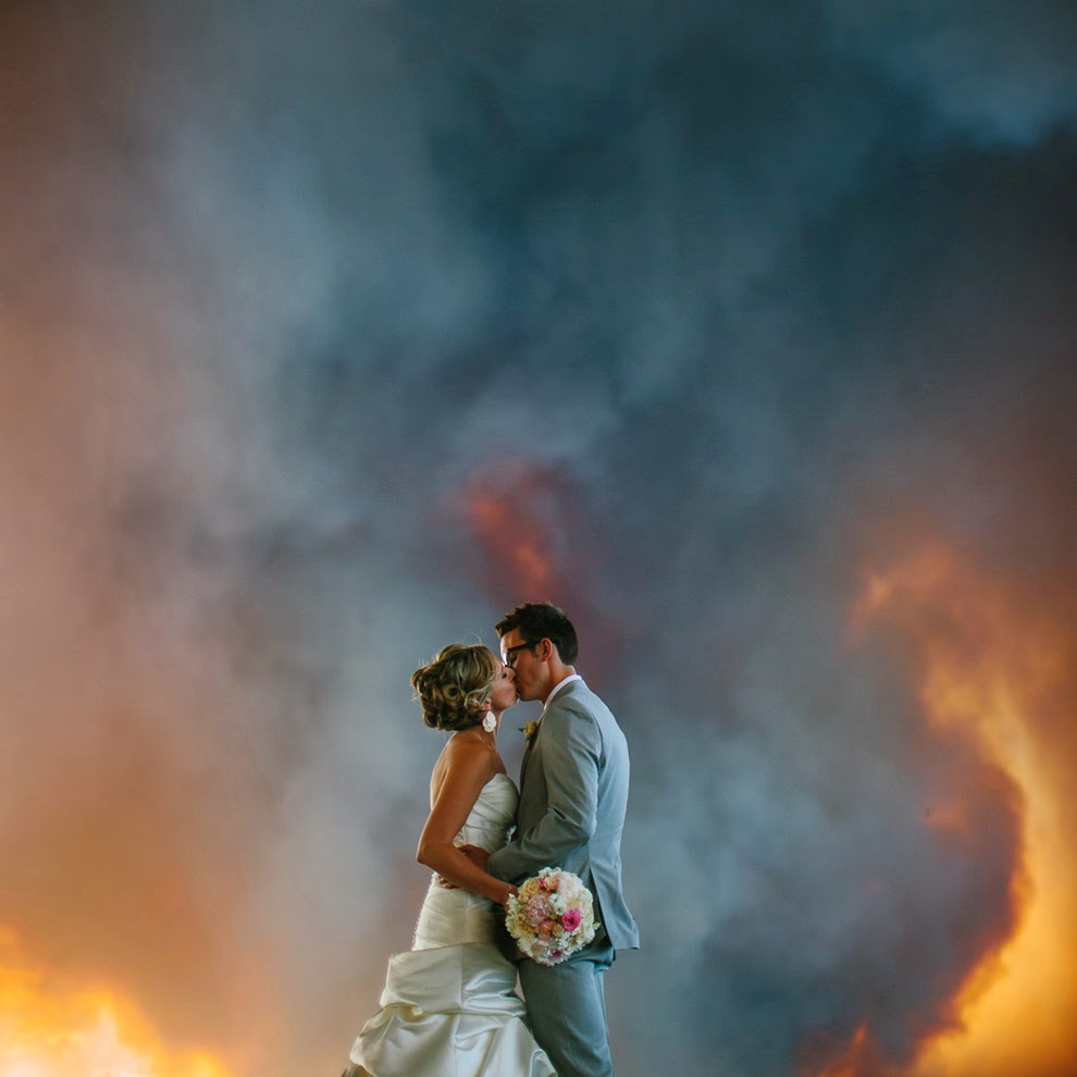 Michael & April kiss with the fire raging in the background on their Wedding Day!