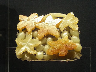 Jade piece showing grape motif dating from 1115-1234 AD at the Shanghai Museum
