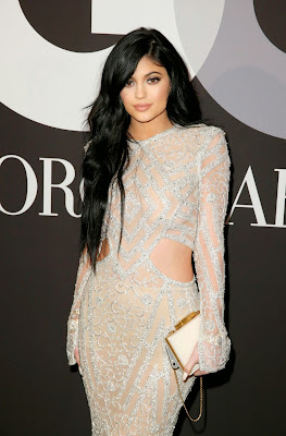 Kylie Jenner in a silver lace gown at GQ and Giorgio Armani Grammys after-party in Hollywood
