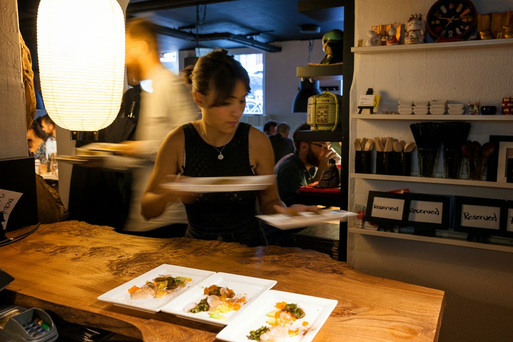 Server runs food at Pink Zebra SF pop-up in Copenhagen