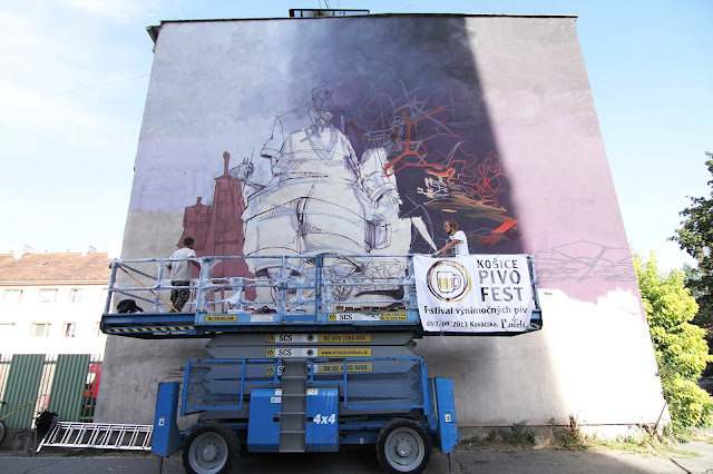 Street artist roem and sepe work in progress in slovakia