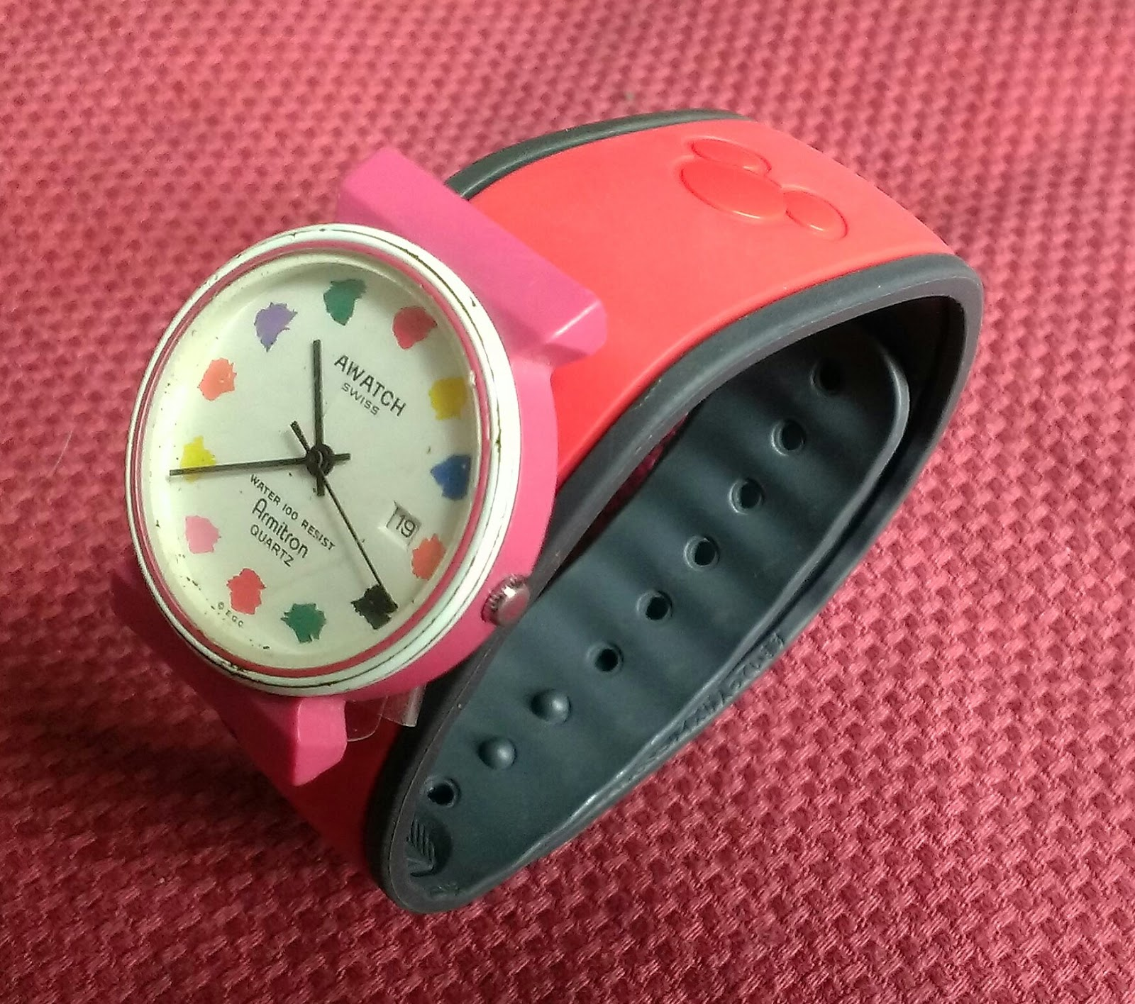 red disney magic band with a watch attached