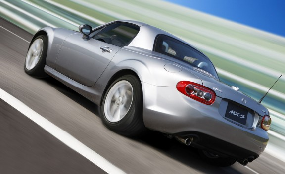Silver 2011 Mazda MX-5 Miata Grand Touring PRHT driving shot
