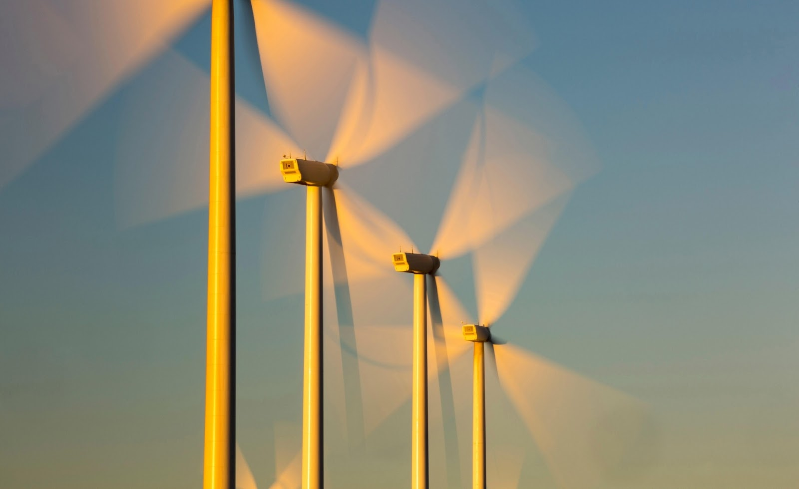 Photograph, Ashley Cooper: Part of the Tehachapi Pass wind farm, the first large scale wind farm area developed in the US, California, USA, at sunrise.