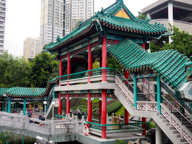 Traditional Chinese architecture of the pavilion on the pond in the garden of Sik Sik Yuen Wong Tai Sin Temple, Hong Kong