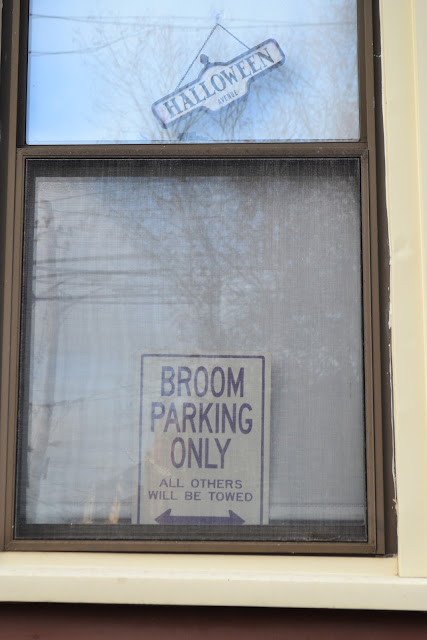 broom parking window sign