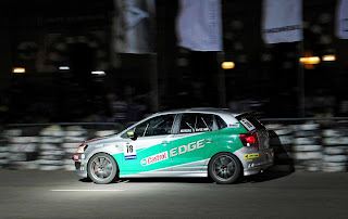 Munjal speeding past the super-charged crowd in Colombo Night Race 2012