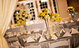 Wedding decor with grey tablecloths & yellow centerpieces - Kent Buttars, Seattle Wedding Officiant