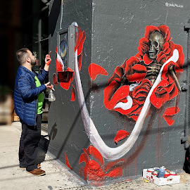 Saúl Palosr painting his street art mural at Soho House.