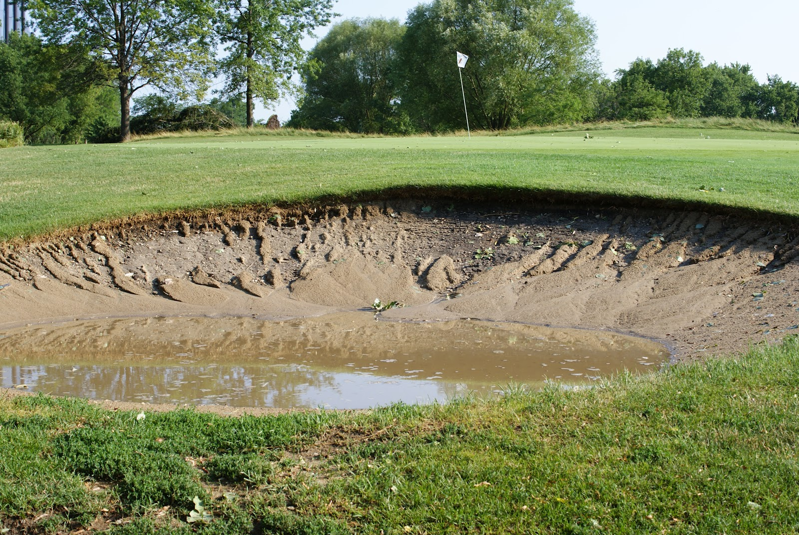 Sugar creek golf course blog week of july 4th brings wind storm and heat wave - Wand trap ...