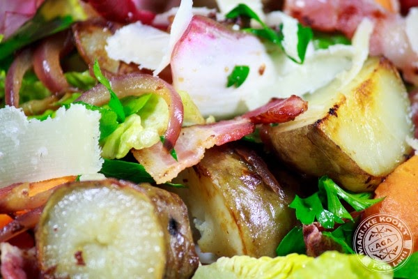 Warme salade met aardpeer, bataat en spek