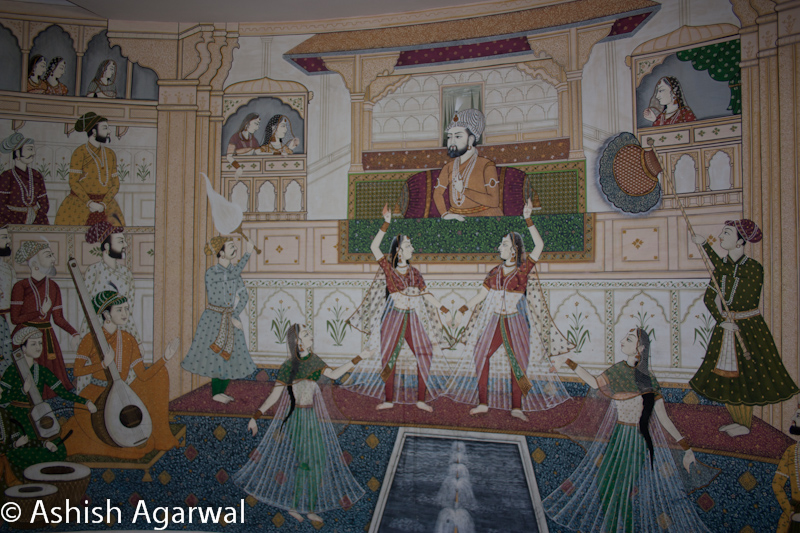 Painting inside the Gold Palace resort on the outskirts of Jaipur, showing the Mughal emperor listening to music