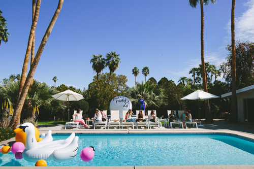 pool in Palm Springs with blow up swan