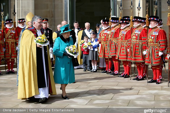 Queen Elizabeth II walks with the Dean of Sheffield Peter Bradley as she leaves Sheffield Cathedral for the traditional Royal Maundy Service at Sheffield Cathedral