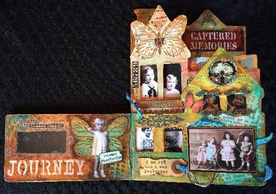 Altered mixed media children's book using primarily DecoArt products.