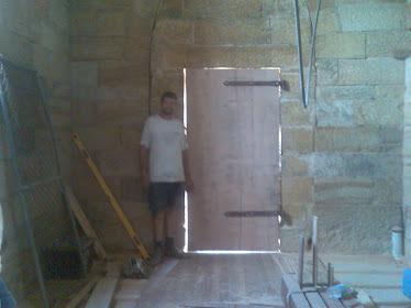 That me standing inside the church with our new door proud as punch
