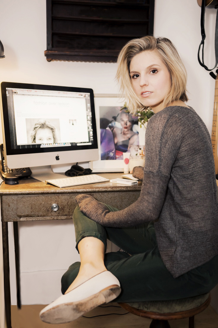 Helene Heath from Fashion Over Reason home office, vintage metal desk, Mac Apple desktop computer, Kate Moss by Mert & Marcus frame, Helmut Lang knitwear, at work,