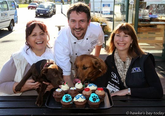 L-R: Ivy Morley, president, Napier SPCA, with Milly, a Labrador kelpie; Jason Heaven, managing director, Heaven's Bakery, Greenmeadows, Napier; Faye Johnson, fundraising manager, Hastings SPCA, with Mahli, a border collie cross - promo for SPCA Cupcake Day. photograph