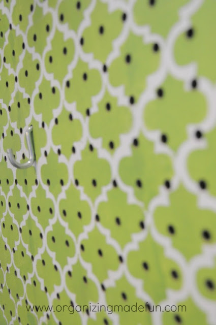 Laundry Room wall with stencilled pegboard to cover ugly pipes | OrganizingMadeFun.com