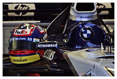 Juan Pablo Montoya helmet sits on car William garage Silverstone