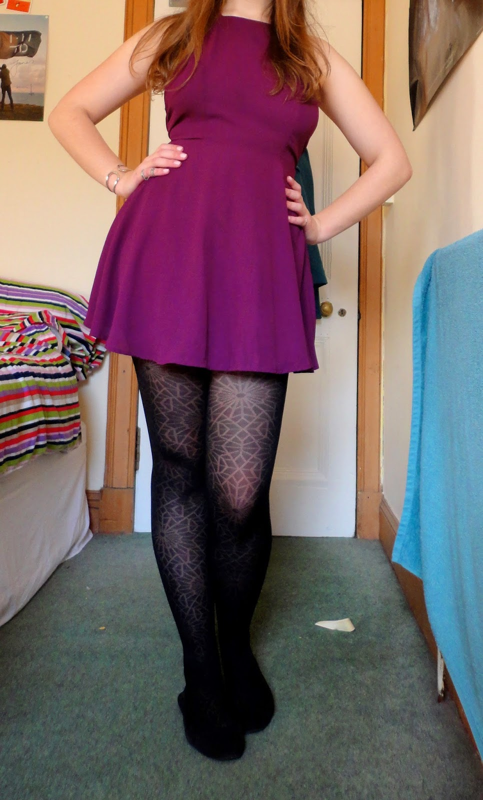 short purple dress with black flat shoes and tights