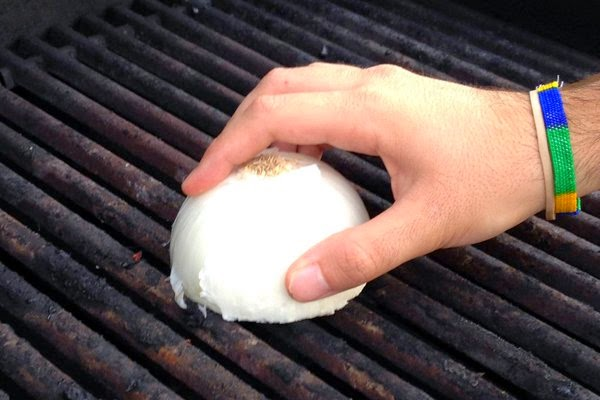 Cut An Onion In Half & Rub It On Your Grill To Clean It