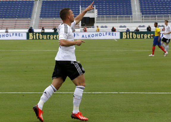 Germany striker Lukas Podolski celebrates his goal in the ninth second of play against Ecuador