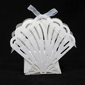 http://www.specialgiftboxes.com/product/laser-cut-shell-shaped-favor-box-ribbon-set-12/