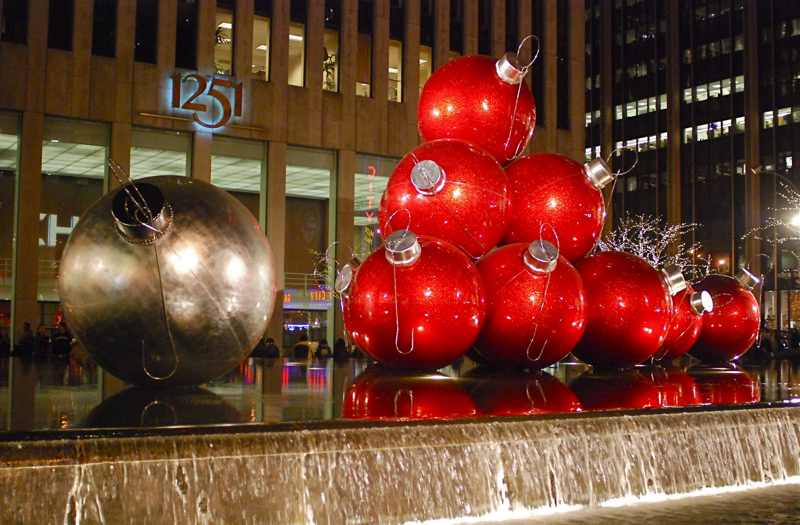 giant christmas ornaments at 1251 sixth avenue - New York Christmas Decorations