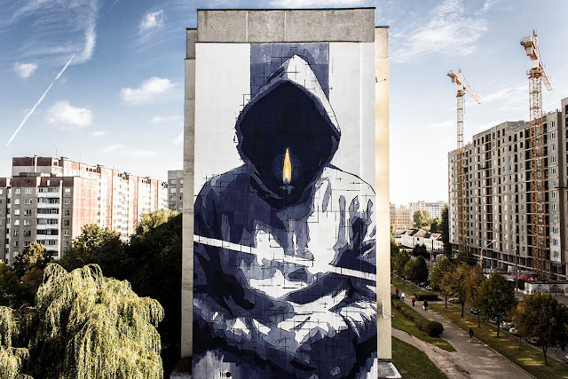 "Ino was recently invited by the Ministry of Culture of Belarus to create a mural for a project called ""Urban Myths"" in Minsk. During only 3 days Greek artist worked on this large new mural titled ""Man With No Name""."