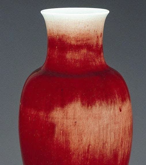mouth oxblood glazed vase with white highlights