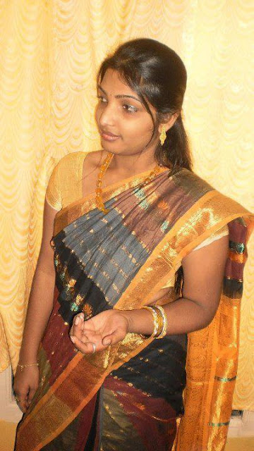 Tamil girl Ramya wearing saree in a party.