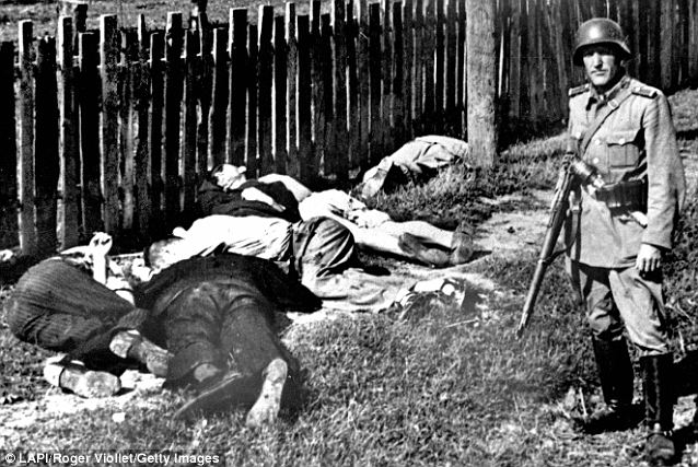 German soldier with dead Russian civilians