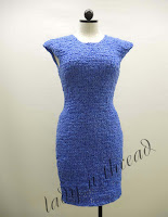 Sustainable fashion – a knit sheath dress using recycled blue wrap (front view)