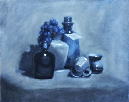 Oil painting in blue of two bottles, two vases, a cup with a handle lying on its side and a bunch of plastic grapes.