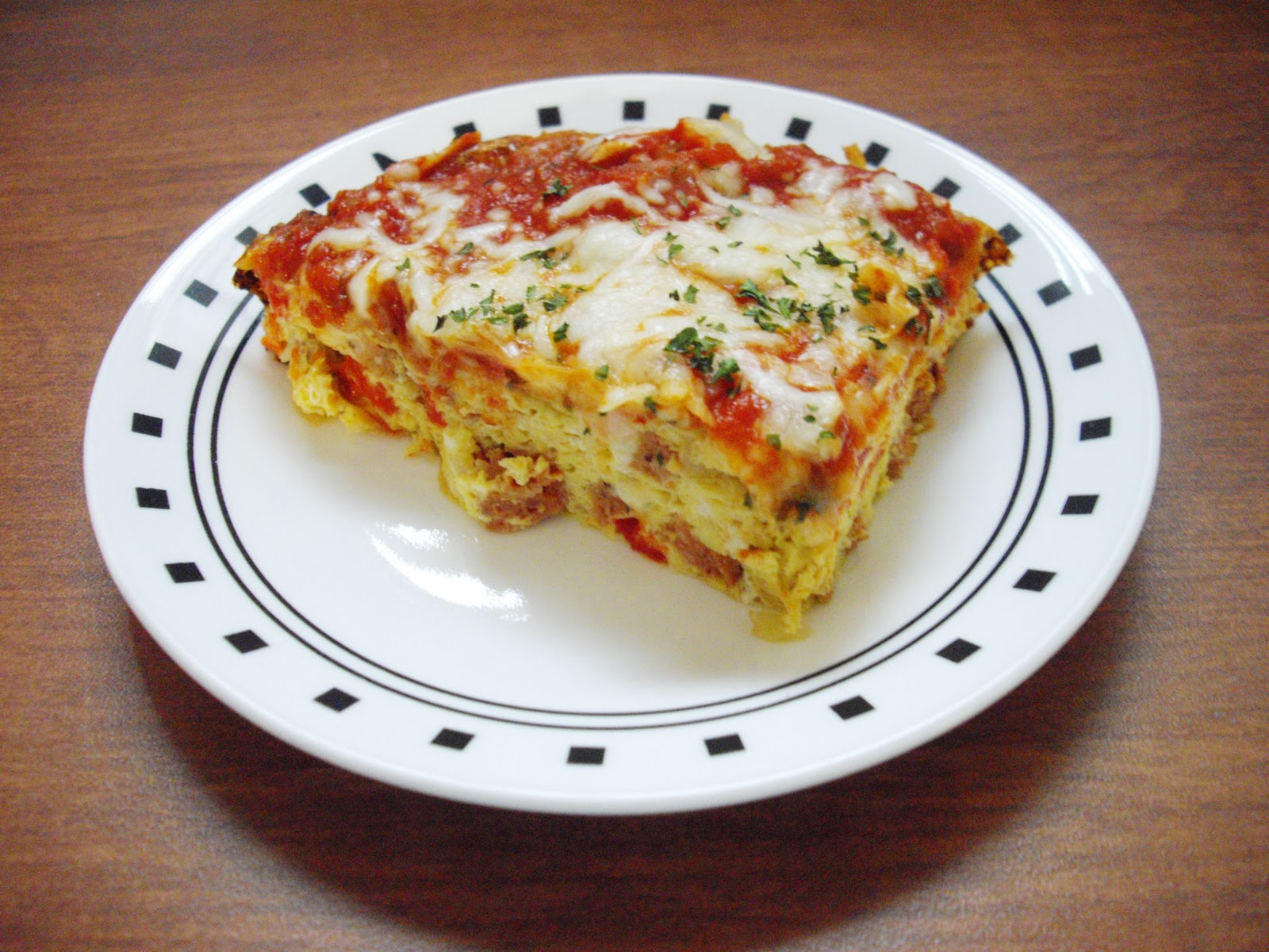 The frittata is topped with some marinara and mozzarella; they really ...