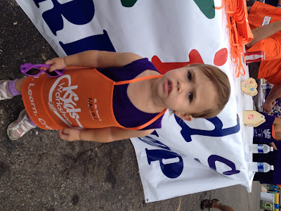 toddler with home depot apron