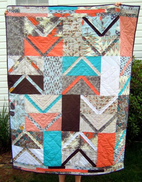 http://quiltyhabit.blogspot.com/2014/07/point-me-tutorial-and-finished-quilt.html