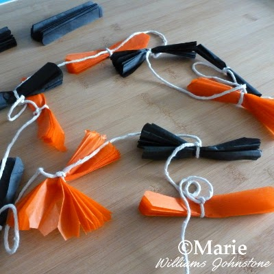 Black and orange color strips of paper tied onto cord