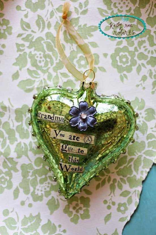 http://gardengalleryironworks.com/collections/2015-kelly-rae-roberts/products/glass-heart-ornament-grandma