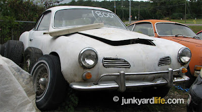 This white 1966 Volkswagen Karmann Ghia project had a price of $1800 on the windshield.