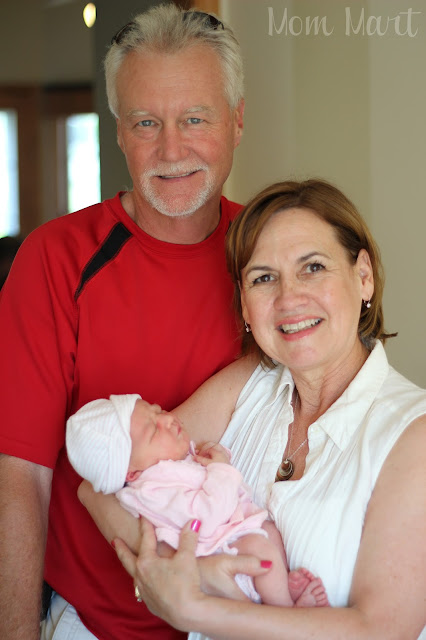Grandma and Grandpa with Newborn Baby Girl Julia