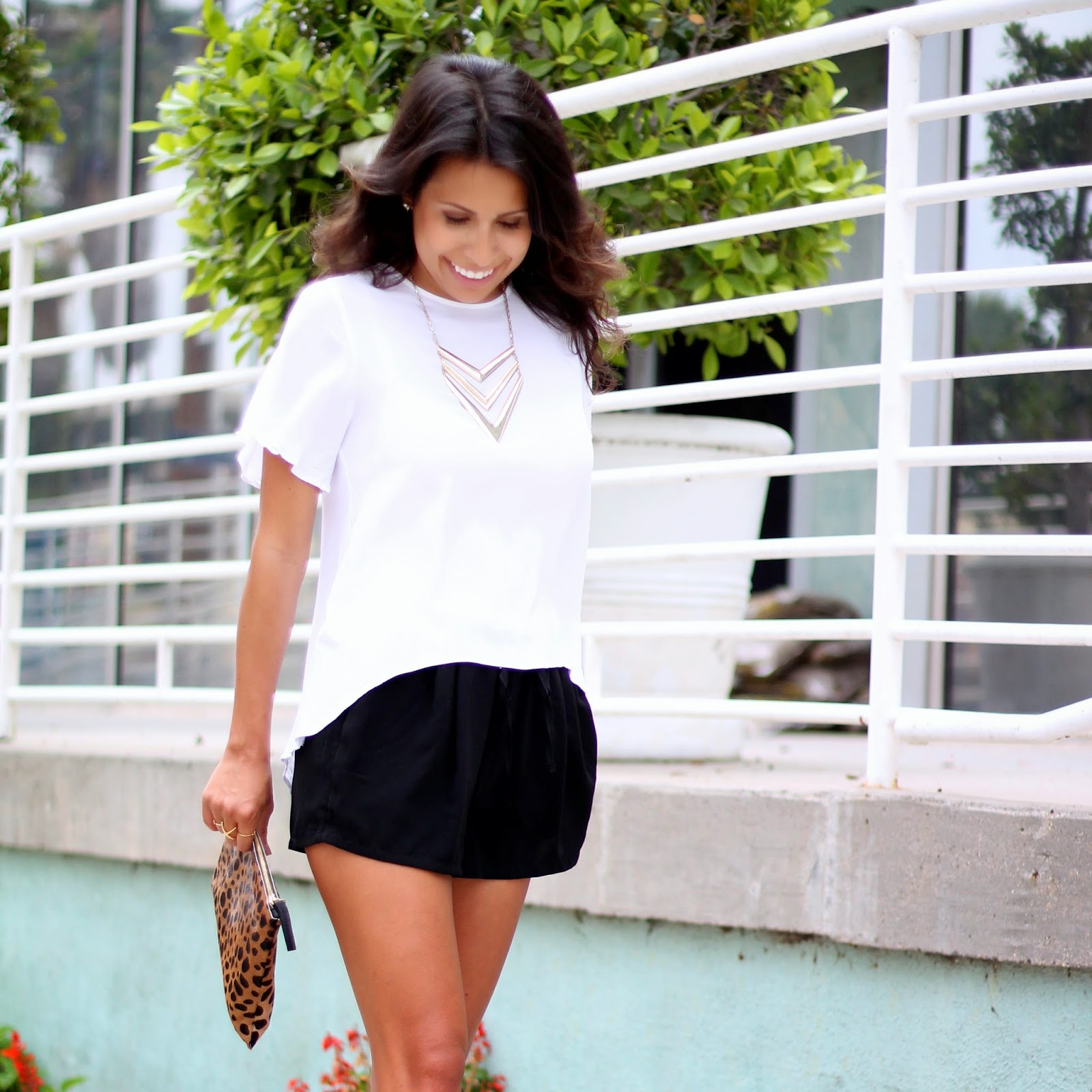 clare vivier clutch, how to wear heels and shorts, white black outfit