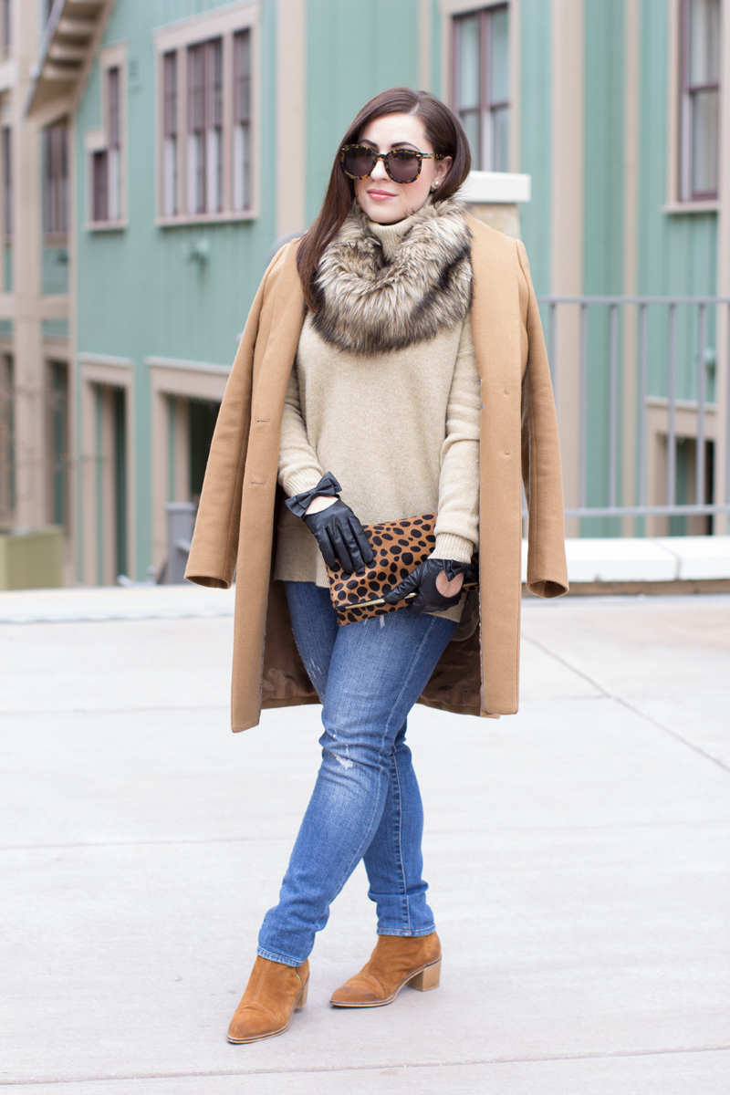 camel coat, brown suede boots, leather moto gloves, tan sweater