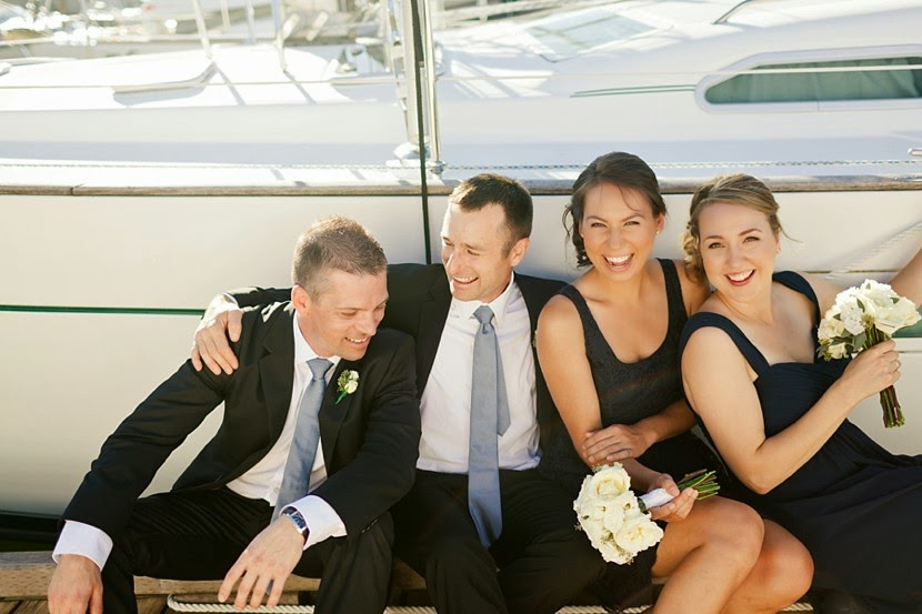 bridal party with sailboats photo