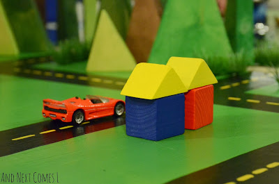 Block houses and cars on DIY road table from And Next Comes L