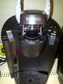 Keurig coffee brewer with top open